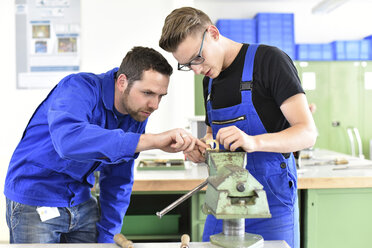 Instructor with trainee at workbench - LYF00619
