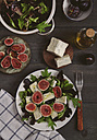 Plate of mixed lettuce with fresh figs, goat cheese and olive oil - RTBF00470