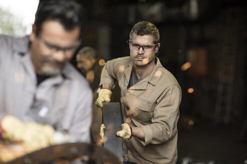 Steel workers in metal construction factory - ZEF11205