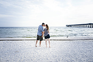 USA, Kissing couple standing at Panama City Beach - SHKF00712