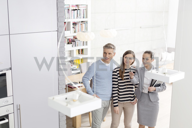 Female real estate agent with couple in house - LOF04577