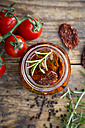Glass of pickled dried tomatoes with rosemary, close-up - LVF05534