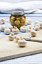 Fresh white champignons and glass of pickled champignons - LVF05550