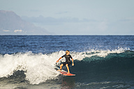 Spain, Tenerife, boy surfing in the sea - SIPF01002
