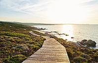 Italy, Sardinia, Lu Litarroni, coastal path at sunset - MRF01653