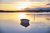 Italy, Sardinia, Murta Maria, boat on the water at sunset - MRF01674