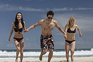 Happy friends running on the beach - ZEF11294