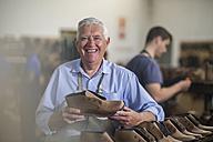 Portrait of smiling shoemaker in workshop - ZEF11327