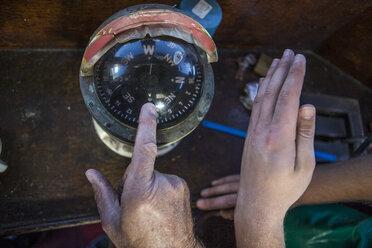 Fishermen checking compass - ZEF11399