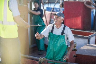 Fisherman on trawler talking to inspector - ZEF11405