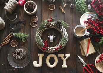 Christmas wreath on wooden table - RTBF00486