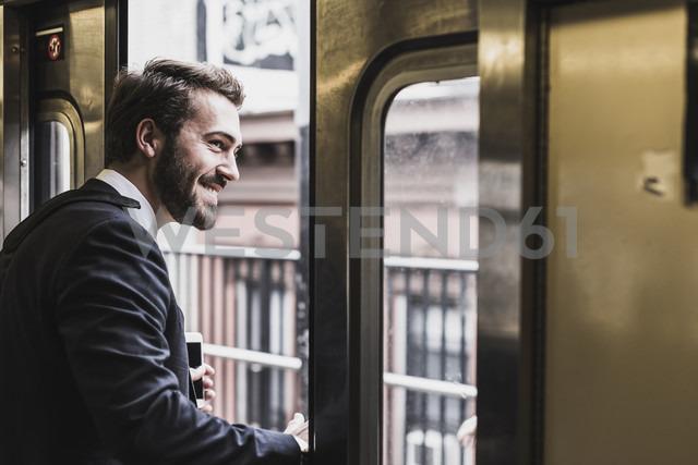 Young businessman taking metro - UUF09012 - Uwe Umstätter/Westend61
