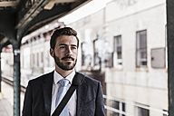 Young businessman waiting at metro station platform - UUF09015