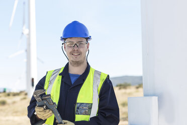 Engineer at wind farm holding wrench - ZEF11516