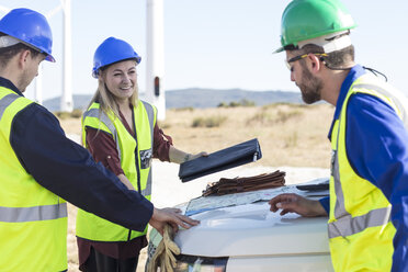 Engineers having a meeting at wind farm - ZEF11519