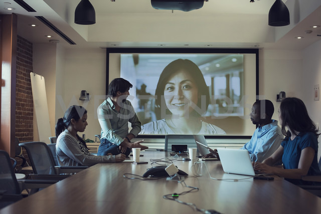Business people having a video conference in board room - WESTF21901