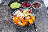 Bowl of autumnal salad with carrots, pumpkin, sweet potatoes, pecan, guacamole, pomegranate and rice - SARF03056