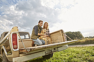Couple with dog on pick up truck - FMKF03167