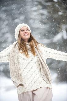 Portrait of smiling blond woman wearing knitwear in winter - HHF05472