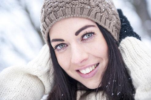 Portrait of smiling woman wearing knitwear in winter - HHF05475