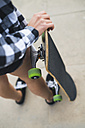 Woman with skateboard, partial view - KKAF00046