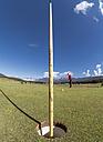 Italy, Veneto, Dolomites, golfer on golf course - LAF01780