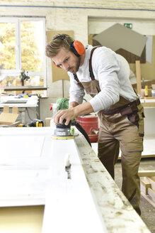 Carpenter restoring a wooden door - LYF00678