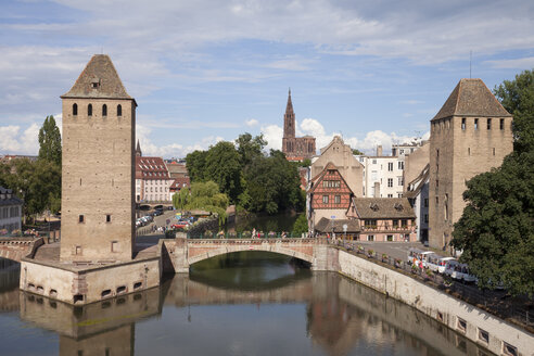 France, Strasbourg, Covered stone bridges and towers in Peteite France at Ill river - WI03374