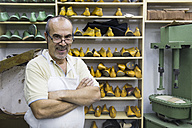 Portrait of a confident shoemaker in his workshop - ABZF01485