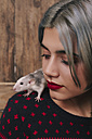 Young woman with pet rat on her shoulder - RTBF00519