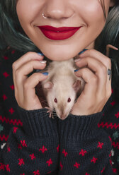 Smilig young woman with pet rat in her hands - RTBF00522