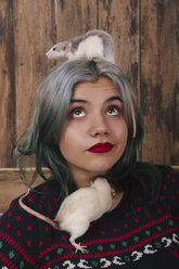 Portrait of young woman with two pet rats wearing patterned knit pullover - RTBF00525