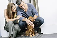 Couple with dog at terrace door - MADF01206