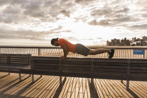 USA, New York City, man exercising on Coney Island - UUF09183