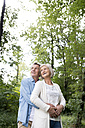 Happy senior couple relaxing together in the woods - HAPF01049