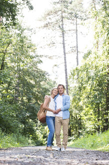 Happy senior couple relaxing together in the woods - HAPF01064