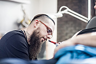 Tattoo artist in studio at work - ZEF11589