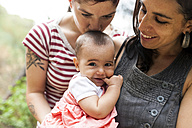 Happy lesbian couple with baby girl - VABF00826