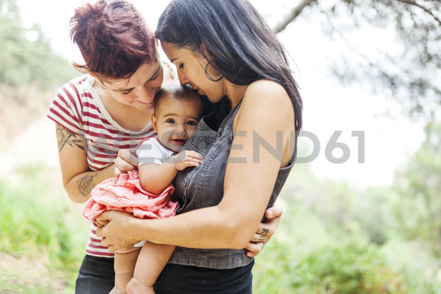 Happy lesbian couple with baby girl - VABF00829