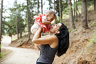 Mother and little daughter together in the forest - VABF00832
