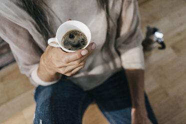 Woman holding cup of coffee - KNSF00484