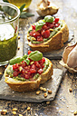 Bruschetta with basil pesto, tomatoes, pine nuts and basil leaves - ODF01463