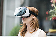 Redheaded woman wearing Virtual Reality Glasses - TAMF00778