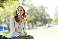 Portrait of smiling woman with ice cream cone - TAMF00799