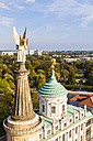 Germany, Potsdam, angel figurine of St. Nicholas church and Atlas of roof top of old city hall - WDF03768