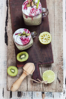 Two glasses of kiwi limes smoothie with coconut cream and raspberry sauce - SBDF03070