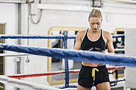 Female boxer in boxing ring - MADF01267