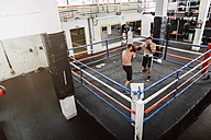 Two boxers fighting in boxing ring - MADF01276