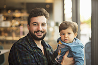 Portrait of father and son in a coffee shop - JASF01297