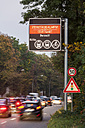 Germany, Stuttgart, Warning sign for particulate pollution on highway - WDF03792